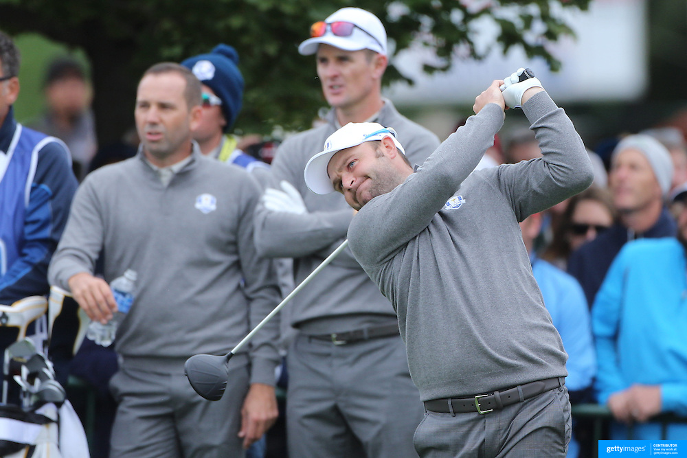 Ryder Cup 2016. Andy Sullivan of Europe during practice day watched by Sergio Garcia and Justin Rose in front of massive crowds at the Hazeltine National Golf Club on September 28, 2016 in Chaska, Minnesota.  (Photo by Tim Clayton/Corbis via Getty Images)
