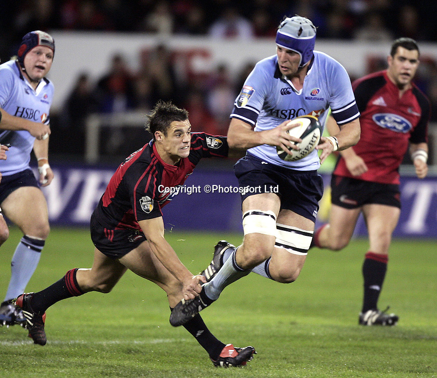 Waratah Daniel Vickerman tripped by Dan Carter during the Rebel Sport Super 12  final rugby match between the Crusaders and the Waratahs at Jade Stadium, Christchurch, New Zealand on Saturday 28 May, 2005.  The Crusaders won 35-25.  Photo : Anthony Phelps/PHOTOSPORT