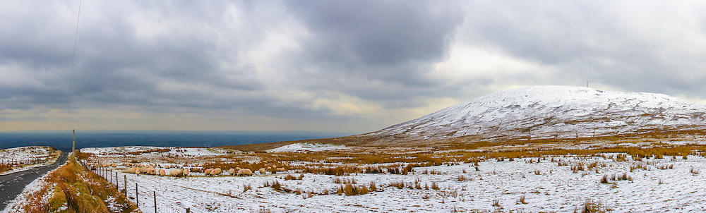 With Winter coming in fast I thought it appropriate to dig out this old snowy shot I got up near Slieve Gallion back in March 2013 when there was a nice covering of snow around. Off to the right you can see Slieve Gallion sweeping across to the left bringing the eye down to the sheep grazing in the foreground and the road leading back down to the valley below.<br />