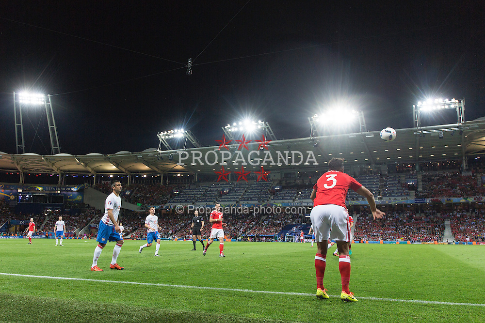 TOULOUSE, FRANCE - Monday, June 20, 2016: Wales' Neil Taylor takes a throw-in during the final Group B UEFA Euro 2016 Championship match against Russia at Stadium de Toulouse. (Pic by Paul Greenwood/Propaganda)