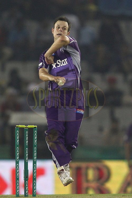 Evan Gulbis of the Hobart Hurricanes sends down a delivery during match 2 of the Oppo Champions League Twenty20 between the Kings XI Punjab and the Hobart Hurricanes held at the Punjab Cricket Association Stadium, Mohali, India on the 18th September 2014<br /> <br /> Photo by:  Shaun Roy / Sportzpics/ CLT20<br /> <br /> <br /> Image use is subject to the terms and conditions as laid out by the BCCI/ CLT20.  The terms and conditions can be downloaded here:<br /> <br /> http://sportzpics.photoshelter.com/gallery/CLT20-Image-Terms-and-Conditions-2014/G0000IfNJn535VPU/C0000QhhKadWcjYs