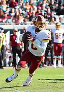 Dec 16, 2018; Jacksonville, FL, USA; Washington Redskins quarterback Josh Johnson (8) scrambles in the pocked during an NFL game against the Jacksonville Jaguars at TIAA Bank Field. The Redskins beat the Jaguars 16-13. (Steve Jacobson/Image of Sport)
