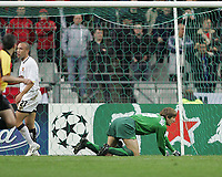 Photo: Lee Earle.<br /> Lille v Manchester Utd. UEFA Champions League.<br /> 02/11/2005. United keeper Edwin Van Der Sar is left grounded after Acimovic opened the scoring.