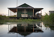 Fishing camp at Lake Boueff in decorated in a Cajun style.  shore of Lake Boeuff, part of Louisiana's wetlands.