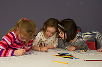 "Karleigh, Evianna and Kali spend time together coloring in the ""Imagination Room"" at the Boys and Girls Club on Monday afternoon as part of the after school program.  (Karen Bobotas/for the Laconia Daily Sun)"
