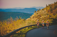 group cycling join the blue ridge parkway at sun set
