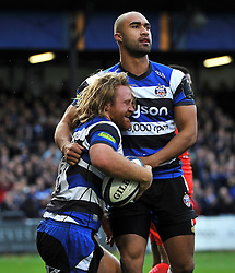 Ross Batty of Bath Rugby celebrates with team-mate Olly Woodburn after scoring a try - Photo mandatory by-line: Patrick Khachfe/JMP - Mobile: 07966 386802 25/10/2014 - SPORT - RUGBY UNION - Bath - The Recreation Ground - Bath Rugby v Toulouse - European Rugby Champions Cup