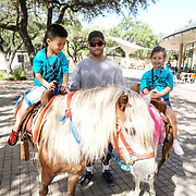"Cardinal Health RBC 2017 Camp Cardinal Rompers ""Ride Em Cowboy"" at Pony Express Pony Rides and Petting Zoo. Photo by Alabastro Photography."