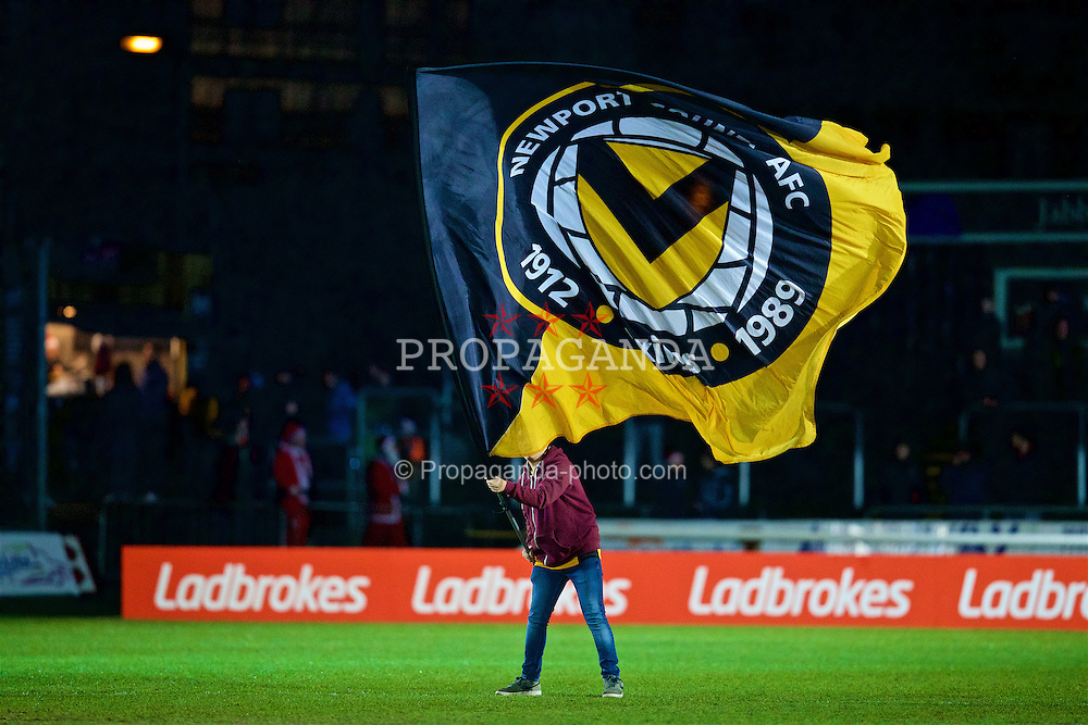 NEWPORT, WALES - Wednesday, December 21, 2016: A Newport County supporter waves a large flag on the pitch before the FA Cup 2nd Round Replay match against Plymouth Argyle at Rodney Parade. (Pic by David Rawcliffe/Propaganda)