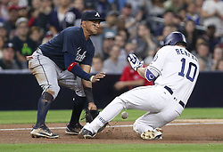 June 28, 2017 - San Diego, CA, USA - The San Diego Padres' Hunter Renfroe (10) slides safely into third base with a two-run triple as Atlanta Braves infielder Johan Camargo takes the throw in the fourth inning at Petco Park in San Diego on Wednesday, June 28, 2017. (Credit Image: © Hayne Palmour Iv/TNS via ZUMA Wire)