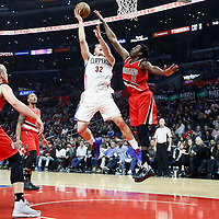 12 December 2016: LA Clippers forward Blake Griffin (32) goes to the basket against Portland Trail Blazers forward Al-Farouq Aminu (8) during the LA Clippers 121-120 victory over the Portland Trail Blazers, at the Staples Center, Los Angeles, California, USA.