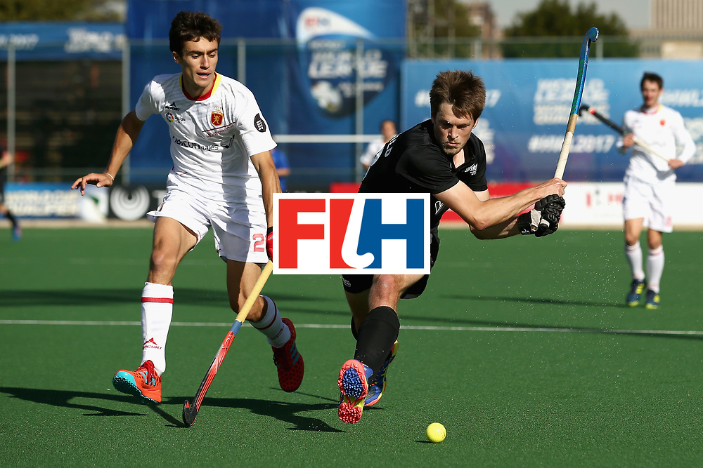 JOHANNESBURG, SOUTH AFRICA - JULY 17: Marcus Child of New Zealand shoots as Marc Serrahima of Spain attempts to block during the Group A match between Spain and New Zealand on day five of the FIH Hockey World League - Men's Semi Finals on July 17, 2017 in Johannesburg, South Africa.  (Photo by Jan Kruger/Getty Images for FIH)