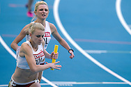 (FRONT) Patrycja Wyciszkiewicz and (BACK) Malgorzata Holub both from Poland compete in women's relay 4x400 meters qualification during the 14th IAAF World Athletics Championships at the Luzhniki stadium in Moscow on August 16, 2013.<br /> <br /> Russian Federation, Moscow, August 16, 2013<br /> <br /> Picture also available in RAW (NEF) or TIFF format on special request.<br /> <br /> For editorial use only. Any commercial or promotional use requires permission.<br /> <br /> Mandatory credit:<br /> Photo by © Adam Nurkiewicz / Mediasport