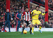 Brentford defender Nico Yennaris and Nottingham Forest forward Ryan Mendes jostling for the ball during the Sky Bet Championship match between Brentford and Nottingham Forest at Griffin Park, London, England on 21 November 2015. Photo by David Charbit.