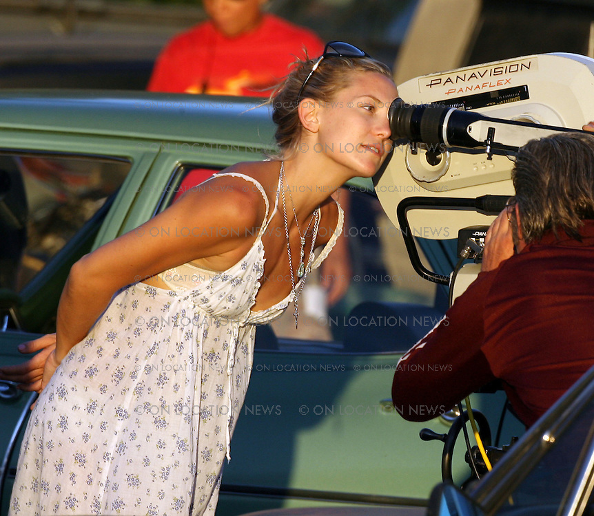July 27th 2007 Pasadena, California. ***EXCLUSIVE*** Kate Hudson makes her directorial debut while directing the film Cutlass starring her dad Kurt Russell. Photo by Eric Ford 818-613-3955 info@onlocationnews.com