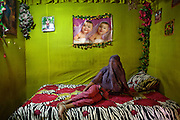 Asia, Bangladesh October 2012: .Gayatri, dance for a client on a bollywood theme song in her room. .There is a brothel in Bangladesh that services 3,000 men a day. Sixteen hundred women live and work there.  Daulatdia, the biggest brothel in Bangladesh October 2012.  ©GIULIO DI STURCO...