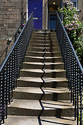 Worn Victorian steps and terraced housing on Teviotdale Place alongside the Waters of Leith, in Edinburgh, on 26th June 2019, in Edinburgh, Scotland.