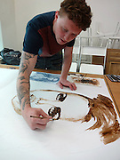 """Artist immortalises his favourite Essex celebs using bronzer as paint<br /> <br /> AN ARTIST has paid tribute to Essex celebrities by painting their portraits using fake tan. <br /> Nathan Wyburn has created images of famous faces including X Factor contestant now TV presenter Rylan Clark, model Jodie Marsh and reality star Joey Essex. <br /> The 23-year-old artist, who lives in Cardiff, is best known for his appearance on Britain's Got Talent in 2011, when he used Marmite to paint comedian Michael McIntyre's face on to slices of toast. <br /> Nathan said: """"I'm always thinking of new, exciting materials to create art with. The list of things I've used are endless, from food stuffs such as sugar and ketchup to everyday items such as tooth paste, candles and make-up."""" <br /> He said he was not making fun of Essex stereotypes: """"The intention isn't to insult the celebrities in any way, but to simply highlight a part of their personality. Jodie Marsh 'tans up' for bodybuilding contests and glamour shoots. Rylan always referred to his Essex background and highlighted the fact he loved fake tan, just like the stars of TOWIE such as Joey Essex."""" <br /> The artist presented Rylan Clark with his portrait in person. Nathan explained: """"He said it was the best gift he'd ever been given – unique and personal. It's now on display at his mother's house and was even shown during his video on All Star Family Fortunes."""" <br /> He said he was not finished with his Essex collection, with more portraits still to come. """"I have a few more Essex-inspired fake tan creations in the pipeline. <br /> """"Maybe an Amy Childs one. She's gone on to great success and it would celebrate that."""" <br /> ©Nathan Wyburn/Exclusivepix"""