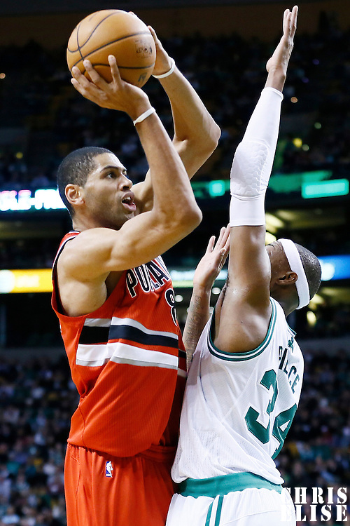 30 November 2012: Portland Trail Blazers small forward Nicolas Batum (88) takes a jumpshot over Boston Celtics small forward Paul Pierce (34) during the Boston Celtics 96-78 victory over the Portland Trail Blazers at the TD Garden, Boston, Massachusetts, USA.