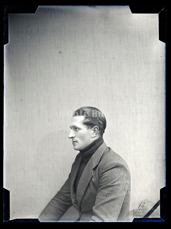 side view studio portrait of a young adult man circa 1930s