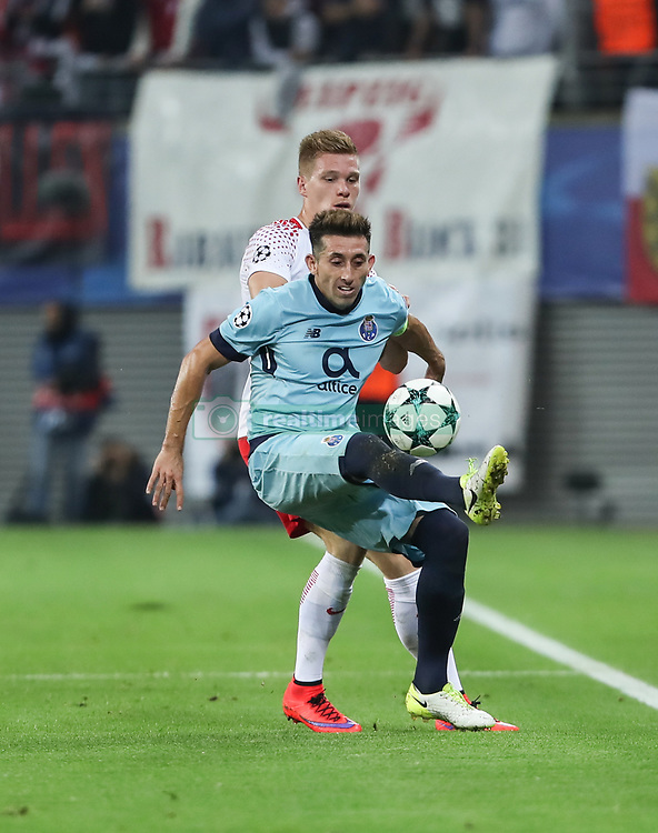 LEIPZIG, Oct. 18, 2017 Leipzig's Marcel Halstenberg (back) vies with Porto's Hector Herrera during a match of Group G of 2017-18 Champions League in Leipzig, Germany, on Oct. 17, 2017. Leipzig won 3-2. (Credit Image: © Shan Yuqi/Xinhua via ZUMA Wire)