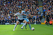 Fulham FC midfielder Tom Cairney (10) challenges Queens Park Rangers forward Conor Washington (9) during the EFL Sky Bet Championship match between Fulham and Queens Park Rangers at Craven Cottage, London, England on 1 October 2016. Photo by Jon Bromley.