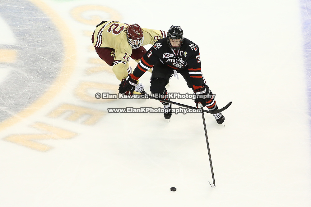Josh Manson #3 of the Northeastern Huskies and Kevin Hayes #12 of the Boston College Eagles fight for the puck during The Beanpot Championship Game at TD Garden on February 10, 2014 in Boston, Massachusetts. (Photo by Elan Kawesch)