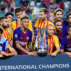 (R-L)  Andres Iniesta and Neymar Jr of Barcelona lift the tournament winner's trophy after the International Champions Cup match between Barcelona and Real Madrid at Hard Rock Stadium on July 29, 2017 in Miami Gardens, Florida. (Photo by Dave Winter/Icon Sport)