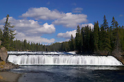 Cave Falls, located in the southwest portion of Yellowstone National Park in Wyoming, may only be 20 feet tall, but it stretches 250 feet across the Falls River. Cave Falls, the widest waterfall in Yellowstone, is named for a 50-foot cave at its base. While Cave Falls is in Wyoming, it can only be accessed from a road in Idaho.