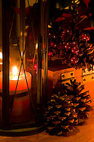 A warm Christmas still-life glows with light from an old fashioned lantern.