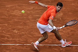 May 30, 2019 - Paris, France - Serbia's Novak Djokovic plays a backhand return to Switzerland's Henri Laaksonen during their men's singles second round match on day five of The Roland Garros 2019 French Open tennis tournament in Paris on May 30, 2019. (Credit Image: © Ibrahim Ezzat/NurPhoto via ZUMA Press)