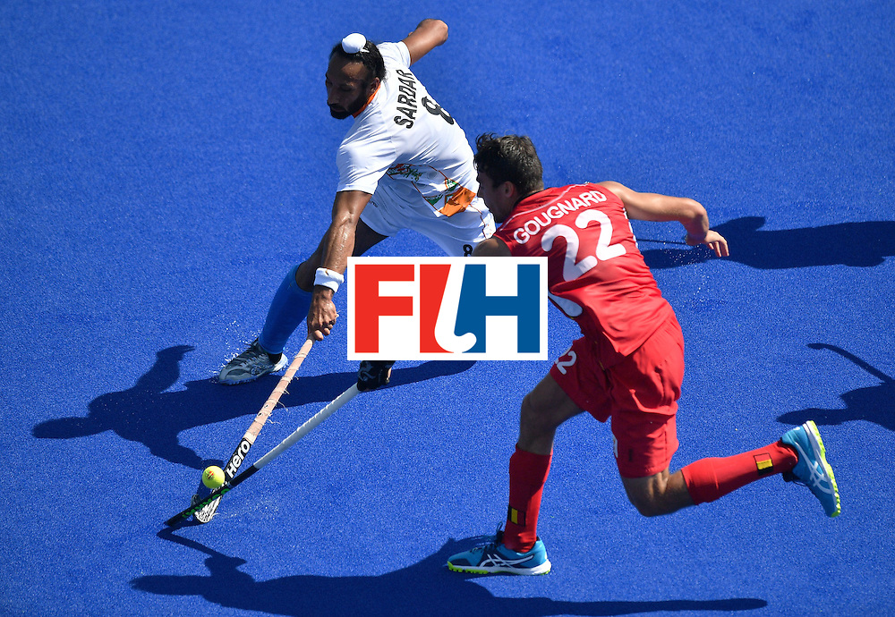 India's Sardar Singh (L) vies with Belgium's Simon Gougnard during the men's quarterfinal field hockey Belgium vs India match of the Rio 2016 Olympics Games at the Olympic Hockey Centre in Rio de Janeiro on August 14, 2016. / AFP / Carl DE SOUZA        (Photo credit should read CARL DE SOUZA/AFP/Getty Images)