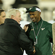 UCF Knights head coach George O'Leary (left) and USF Bulls head coach Willie Taggart shake hands prior to an NCAA football game between the South Florida Bulls and the 17th ranked University of Central Florida Knights at Bright House Networks Stadium on Friday, November 29, 2013 in Orlando, Florida. (AP Photo/Alex Menendez)