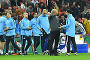 Manchester City manager Pep Guardiola on the field after 90 minutes as the final goes to extra time during the Carabao Cup Final match between Chelsea and Manchester City at Wembley Stadium, London, England on 24 February 2019.