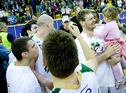 Miha Zupan with his daughter celebrate at third finals basketball match of Slovenian Men UPC League between KK Union Olimpija and KK Helios Domzale, on June 2, 2009, in Arena Tivoli, Ljubljana, Slovenia. Union Olimpija won 69:58 and became Slovenian National Champion for the season 2008/2009. (Photo by Vid Ponikvar / Sportida)