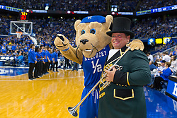 Keeneland sponsored the game against LSU, Saturday, March 05, 2016 at Rupp Arena in Lexington. Keeneland bugler Steve Buttleman, right had his photo taken with Scratch during halftime.