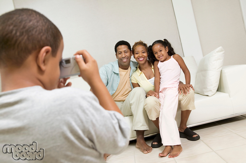 Boy Taking Picture of Family