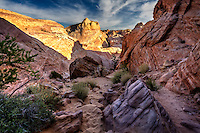 Valley of Fire State Park in Nevada truly does portray itself and a valley of fire. Here a trail winds through the rocky canyon of the White Dome area of the park.
