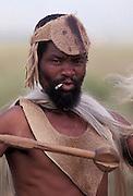 Zulu warrior smoking and ready for battle. South Africa. Kwa Zulu Natal. Isandlwana..©Zute Lightfoot .DVD0018