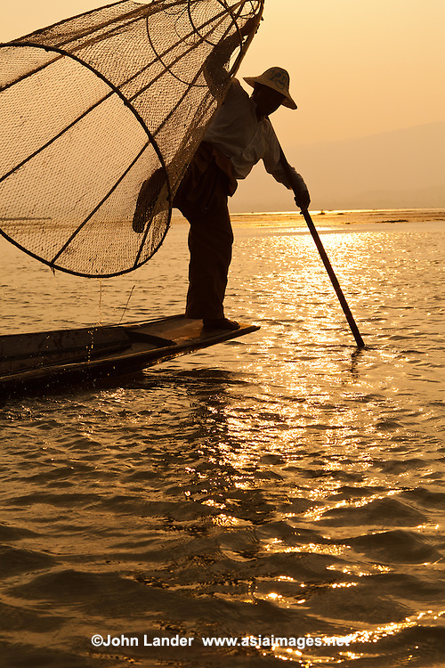 Most Intha people who live on and around Inle Lake get around by using traditional skiffs propelled by a single paddle.  The curious Intha method of leg rowing - one leg is wrapped around the paddle, driving the blade through the water in a unique motion.  The Intha make up the bulk of the fishermen on the lake.