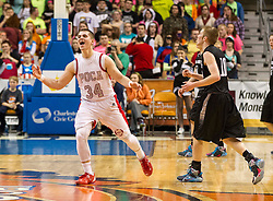 Poca guard Noah Frampton (34) celebrates at mid court against Westside during a semi-final game at the Charleston Civic Center.
