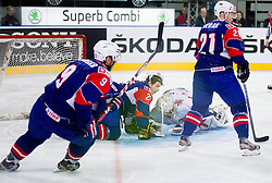 Rok Pajic of Slovenia and Stephen Murphy of Great Britain  during ice-hockey match between Great Britain and Slovenia at IIHF World Championship DIV. I Group A Slovenia 2012, on April 15, 2012 in Arena Stozice, Ljubljana, Slovenia. (Photo by Vid Ponikvar / Sportida.com)