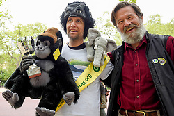 "© Licensed to London News Pictures. 29/04/2017. London, UK. Met Police officer Tom Harrison, 41, known as ""Mr Gorilla"", celebrates with Ian Redmond, Chairman of The Gorilla Organisation, after finally completing the London Marathon after six days of crawling and raising £23,900 for The Gorilla Organisation.   Photo credit : Stephen Chung/LNP"