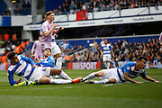 Reading midfielder George Evans' (4) has a shot on goal and causes three QPR players to throw them selves at it during the Sky Bet Championship match between Queens Park Rangers and Reading at the Loftus Road Stadium, London, England on 23 April 2016. Photo by Andy Walter.