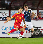 FYR Macedonia's Filip Pivkovski and Scotland's Liam Smith during Scotland Under-21 v FYR Macedonia,  UEFA Under 21 championship qualifier  at Tynecastle, Edinburgh. Photo: David Young<br /> <br />  - © David Young - www.davidyoungphoto.co.uk - email: davidyoungphoto@gmail.com
