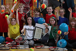 Primary three pupils Holly Anderson (centre right) with Zoe Rae holding a photograph of Andy Murray when he received the Freedom of Stirling alongside classmates at Dunblane Primary as they take a break from the schools Miss-hits Tennis club in Andy Murray's home town of Dunblane, he has said he is aiming to end his career after Wimbledon but the Australian Open may be his last tournament.