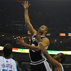 Jan 18, 2010; New Orleans, LA, USA; San Antonio Spurs guard Tony Parker (9) shoots over New Orleans Hornets guard Chris Paul (3) and center Emeka Okafor (50) during the first half at the New Orleans Arena. Mandatory Credit: Derick E. Hingle-US PRESSWIRE