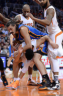 Feb 8, 2016; Phoenix, AZ, USA; Oklahoma City Thunder center Steven Adams (12) lands on top of Phoenix Suns guard Devin Booker (1) at Talking Stick Resort Arena.  The Oklahoma City Thunder won 122- 106.  Mandatory Credit: Jennifer Stewart-USA TODAY Sports
