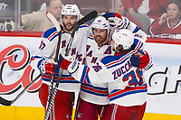 17 May 2014 Brad Richards 19 of The New York Rangers Celebrates His Goal with teammates Benoit Pouliot 67 and Mats Zuccarello 36 in Game One of The Eastern Conference Final during The 2014 NHL Ice hockey men USA Stanley Cup Playoffs Against The Montreal Canadiens AT The Bell Centre in Montreal Quebec Canada NHL Ice hockey men USA May 17 Eastern Conference Final Rangers AT Canadiens Game 1 <br />