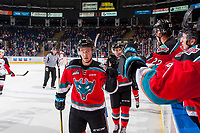 KELOWNA, CANADA - OCTOBER 28: Conner Bruggen-Cate #20 of the Kelowna Rockets skates past the bench and fist bumps teammates to celebrate a goal against the Prince George Cougars on October 28, 2017 at Prospera Place in Kelowna, British Columbia, Canada.  (Photo by Marissa Baecker/Shoot the Breeze)  *** Local Caption ***